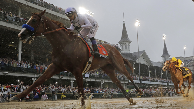 Mike Smith rides Justify to victory during the 144th running of the Kentucky Derby horse race at Churchill Downs Saturday, May 5, 2018, in Louisville, Ky. (AP Photo/Morry Gash)
