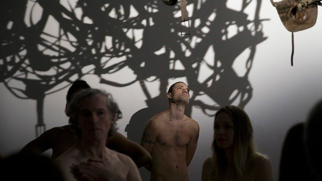 Nudists visit an art exhibition at the Palais de Tokyo museum in Paris May 5, 2018. The museum opened its doors to France's nudist community as they attempt to encourage acceptance of clothes-free activities. (Geoffroy Van Der Hasselt/pool photo via AP)