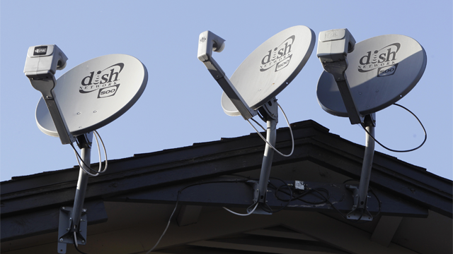 In this Feb. 23, 2011 file photo, three Dish Network satellite dishes, are displayed on an apartment house, in Palo Alto, Calif. (AP Photo/Paul Sakuma, File)