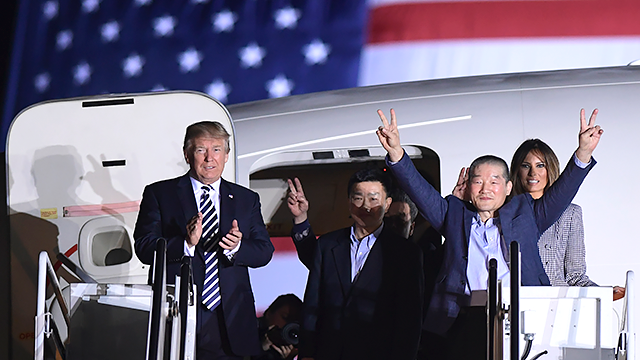President Donald Trump greets the three Americans detained in North Korea for more than a year after they arrived at Andrews Air Force Base in Md., Thursday, May 10, 2018. (AP Photo/Susan Walsh)