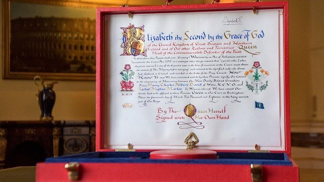 The 'Instrument of Consent', which is the Queen's historic formal consent to Prince Harry's forthcoming marriage to Meghan Markle, photographed at Buckingham Palace in London, Friday May 11, 2018. (Victoria Jones/Pool via AP)