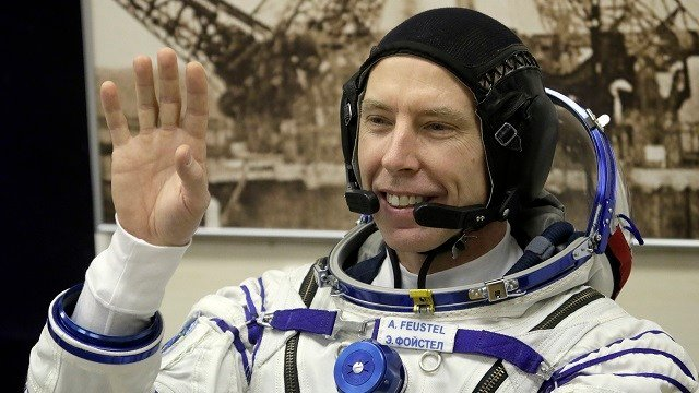 U.S. astronaut Andrew Feustel, member of the crew of the expedition to the International Space Station, waves prior the launch of Soyuz MS-08 space ship at the Russian leased Baikonur cosmodrome in Kazakhstan, March 21, 2018. (AP Photo/Dmitri Lovetsky)
