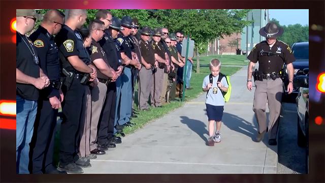 70 officers and deputies escort fallen cop's son back to school