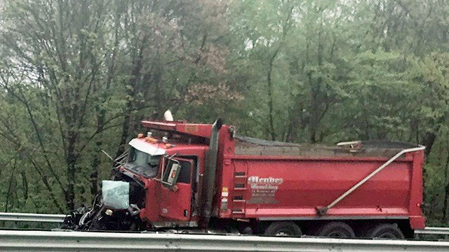 A dump truck sits near the scene after a collision with a school bus in Mount Olive N.J. Thursday