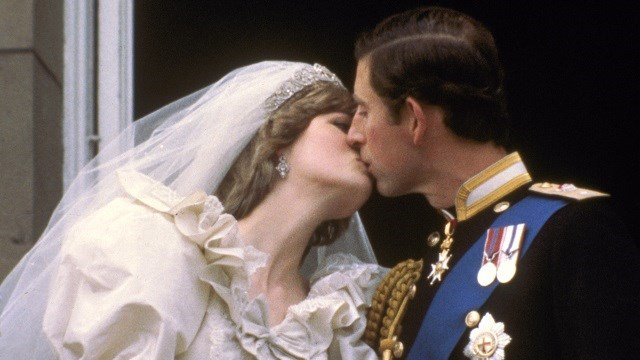 Britain's Prince Charles kisses his bride, the former Diana Spencer, on the balcony of Buckingham Palace in London, after their wedding on July 29, 1981. (AP Photo)