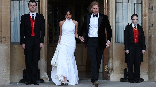 The Duke and Duchess of Sussex, Meghan Markle and Prince Harry, leave Windsor Castle after their wedding in Windsor, England, to attend an evening reception at Frogmore House, hosted by the Prince of Wales May 19, 2018. (Steve Parsons/pool photo via AP)