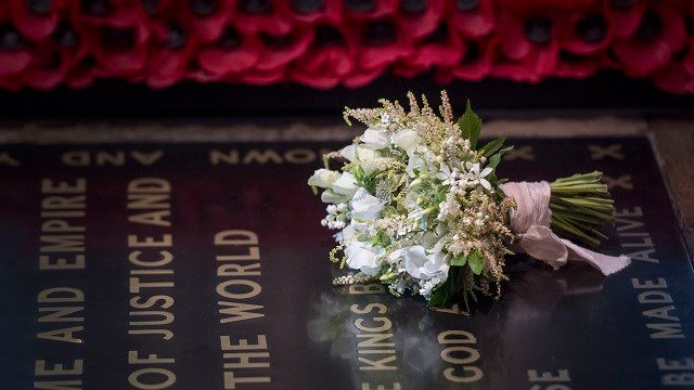 Meghan Markle's wedding bouquet is laid on the grave of the Unknown Warrior in the west nave of Westminster Abbey, London, Sunday May 20, 2018. (Victoria Jones/PA via AP)
