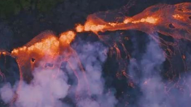 Lava pouring out from four different fissures formed one larger stream, part of which threatens an important way out for lower Puna residents. (KITV)