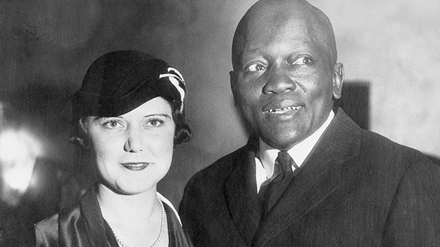 Jack Johnson standing with his fourth wife, Irene Pineau, at the opening of his nightclub, The Showboat, in Los Angeles. The couple were married in 1925, when Johnson was 47 years old. (Getty Images)