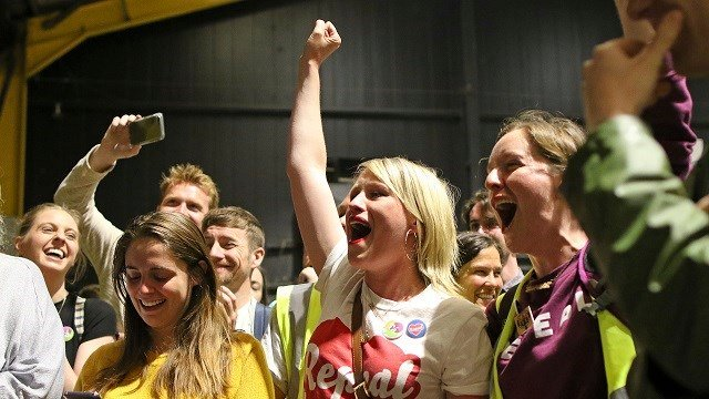 People cheer as voting results begin to come in on May 26, 2018 in Dublin, Ireland. Ireland appeared to embrace a more liberal view as two major exit polls predicted voters had repealed a constitutional ban on abortion. (AP Photo/Peter Morrison)