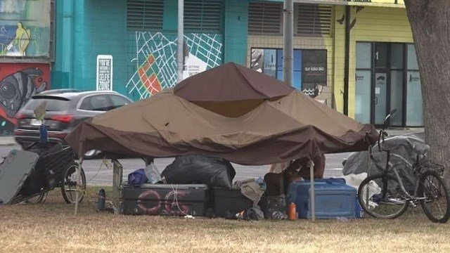 Homeless people were cleared out of one park in Hawaii and relocated to another park just a few blocks away. (KITV via CNN)