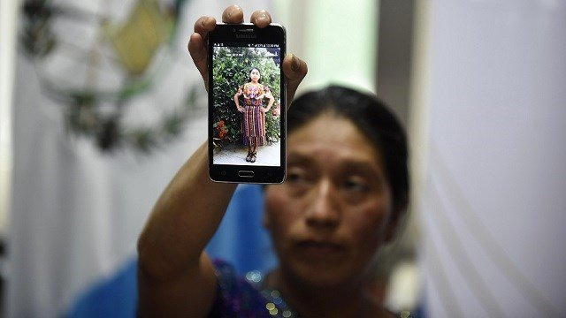 Dominga Vicente shows a photo of her niece Claudia Gomez Gonzalez during a press conference in Guatemala City on May 25, 2018. Gomez Gonzalez was allegedly shot and killed by a U.S. border patrol agent. (JOHAN ORDONEZ/AFP/Getty Images)