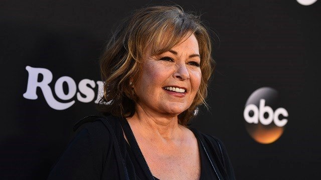 "Roseanne Barr arrives at the Los Angeles premiere of ""Roseanne"" on Friday, March 23, 2018 in Burbank, Calif. (Jordan Strauss/Invision/AP)"