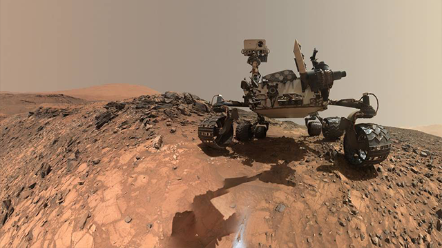 """This low-angle self-portrait of NASA's Curiosity Mars rover shows the vehicle at the site from which it reached down to drill into a rock target called """"Buckskin"""" on lower Mount Sharp. (Credits: NASA/JPL-Caltech/MSSS)"""