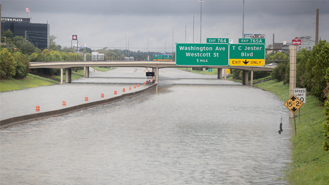 Water flows down Interstate 10 in Houston amid record flooding from Hurricane Harvey. (Scott Olson/Getty Images)