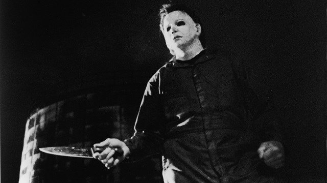 Actor Tony Moran, as masked kiler Michael Myers, wields a knife in a still from the horror film, 'Halloween,' directed by John Carpenter, 1978. (Photo by Fotos International/Courtesy of Getty Images)