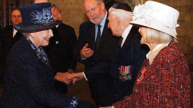 Britain's Queen Elizabeth II, left, meets Holocaust survivor Gena Turgel during a service to remember victims of the Holocaust in Westminster Central Hall in London on Jan. 27, 2005. (Kirsty Wigglesworth, Pool Photo via AP, File)
