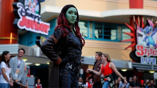 """Gamora"" character of the ""Guardians of the Galaxy"" performs during the opening show at Disneyland Paris June 8, 2018. Disneyland Paris announced a $2.5 billion expansion plan for the park, which will feature Marvel superheroes. (AP Photo/Francois Mori)"