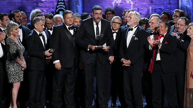 """Orin Wolf, center, and the cast and crew of """"The Band's Visit"""" accept the award for best musical at the 72nd annual Tony Awards at Radio City Music Hall on Sunday, June 10, 2018, in New York. (Photo by Michael Zorn/Invision/AP)"""