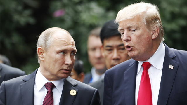 Russian President Vladimir Putin said he talks regularly to US President Trump on the phone. (Jorge Silva/AFP/Getty Images via CNN)