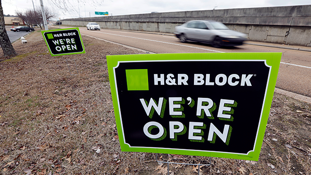 Tax season means extensive, proactive, physical advertising to attract filers who may not want to deal with the details of preparation, as seen by these signs in Jackson, Miss., Wednesday, Feb. 14, 2018. (AP Photo/Rogelio V. Solis)