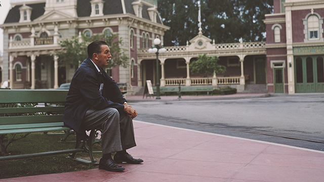 Portrait of American movie producer, artist, and animator Walt Disney (1901 - 1966) as he sits on a bench in his Disneyland amusement park, Anaheim, California, 1950s. (Photo by Gene Lester/Getty Images)