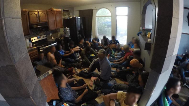 Border Patrol agents, acting on a tip, arrested 62 undocumented immigrants found in a two-bedroom house in Laredo on Tuesday. (US Customs and Border Protection via CNN)