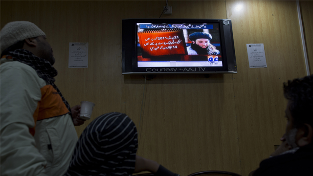 People watch a news report on TV about newly selected leader of Pakistani Taliban leader Mullah Fazlullah at a coffee shop in Islamabad, Pakistan, Thursday, Nov. 7, 2013. (AP Photo/B.K. Bangash)