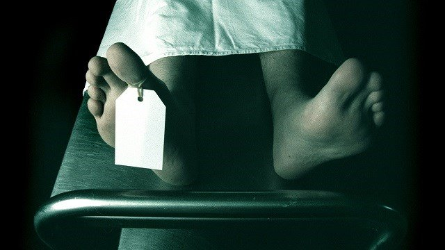 Dead man lying on a trolley in the morgue with toe tag (Photo by Fairfax Media via Getty Images)