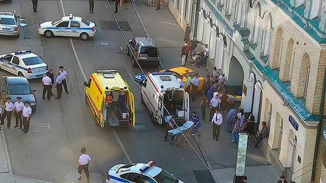 Police work at the site of an incident after a taxi crashed into pedestrians on a sidewalk near Red Square in Moscow, Russia June 16, 2018. (Moscow Traffic Control Center Press Service via AP)
