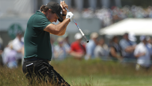 Phil Mickelson reacts to a shot from the fescue on the fifth hole during the third round of the U.S. Open Golf Championship, Saturday, June 16, 2018, in Southampton, N.Y. (AP Photo/Carolyn Kaster)