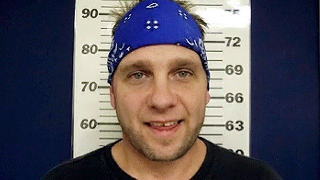 Former 3 Doors Down bassist Todd Harrell poses for a mugshot in February 2014 for a second-offense drug-related charge of DWI. Authorities say Harrell was found slumped behind the wheel of an SUV. (AP Photo/D'Iberville Police Department, File)
