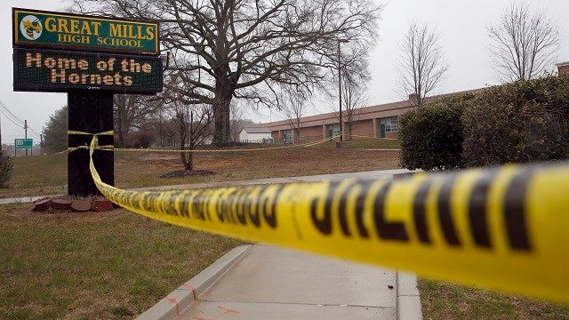 Crime scene tape is used around Great Mills High School, the scene of a shooting, March 20, 2018, in Great Mills. A student shot two classmates in the school before he was fatally wounded by a school resource officer. (AP Photo/Alex Brandon)