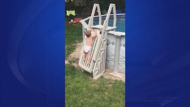 Video of toddler climbing locked pool ladder goes viral