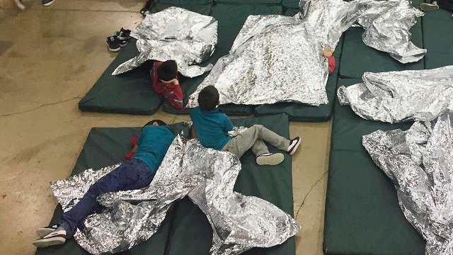 Children who've been taken into custody related to cases of illegal entry into the United States, rest in one of the cages at a facility in McAllen, Texas, Sunday, June 17, 2018. (U.S. Customs and Border Protection's Rio Grande Valley Sector via AP)