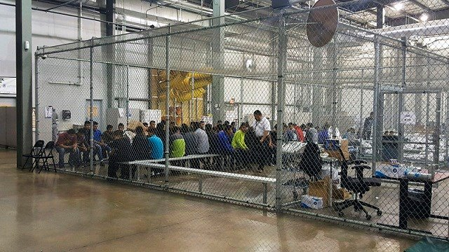 Children who've been taken into custody related to cases of illegal entry into the United States, sit in one of the cages at a facility in McAllen, Texas, Sunday, June 17, 2018. (U.S. Customs and Border Protection's Rio Grande Valley Sector via AP)
