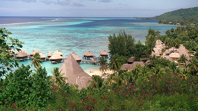 Overwater bungalows are common on Moorea Island, as seen here at the Hotel Sofitel Ia Ora in French Polynesia, Sept. 5, 2001. The hotel has one of the best beaches and lagoons on Moorea, and is the only resort with a view of Tahiti. (AP Photo)