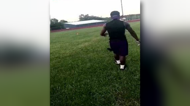 City officials are investigating a video that appears to show a man gleefully punting a cat on a Kansas City high school football field. (City of Kansas City)