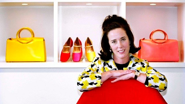 In this May 13, 2004 file photo, designer Kate Spade poses with handbags and shoes from her next collection in New York.  (AP Photo/Bebeto Matthews, File)