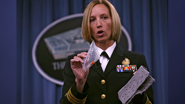 Director of Medical Programs for DoD Chemical and Biological Defense Cdr. Franca Jones demonstrates the protocol for shipping anthrax sample during a news briefing on the DoD Lab Review and Anthrax shipment investigation June 3, 2015. (Getty Images)