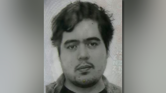 This photo provided by the Goochland County Sheriff's Office shows a New Zealand passport photo, of Troy George Skinner.