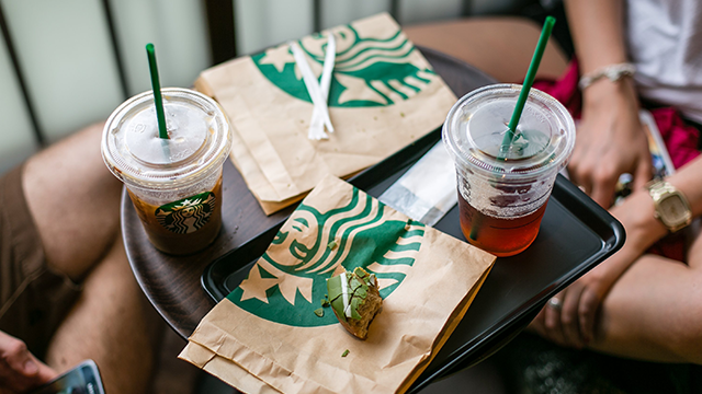 Starbucks wants to be the place you pick up your coffee and go, but also the place where you order and stay. (Getty Images)