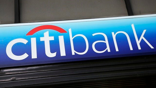 In this Jan. 15, 2015, file photo, a Citibank sign hangs above a branch office in New York. (AP Photo/Mark Lennihan, File)