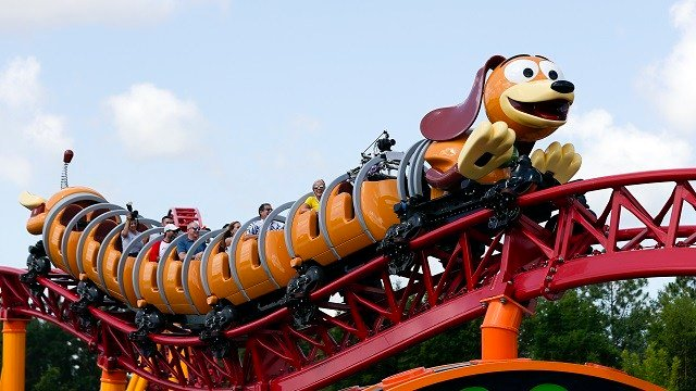 In this Saturday, June 23, 2018 photo, guests ride the Slinky Dog Dash coaster at Toy Story Land in Disney's Hollywood Studios at Walt Disney World in Lake Buena Vista, Fla. (AP Photo/John Raoux)
