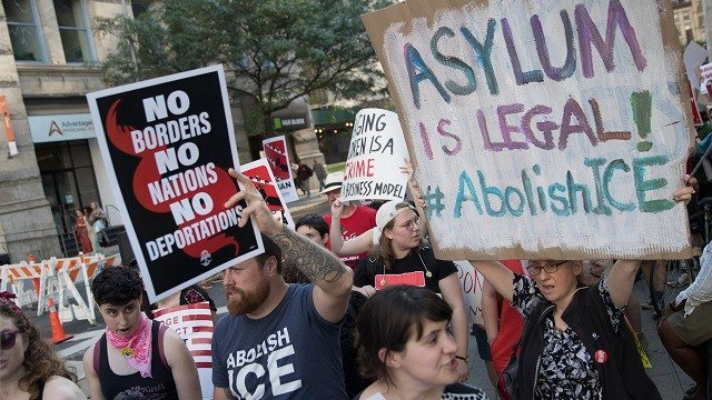 Protesters chant slogans outside a Federal court during a demonstration calling for the abolishment of Immigration and Customs Enforcement [ICE] and demand changes in U.S. immigration policies June 29, 2018, in New York. (AP Photo/Mary Altaffer)