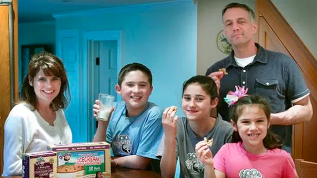 (Gary Higgins/The Patriot Ledger via AP). In this April 28, 2011 photo, Paula, left, and husband Chris White, standing at right, pose with their children and some of their 600 lb Gorillas frozen ice cream sandwiches and cookies in Duxbury, Mass. The 60...