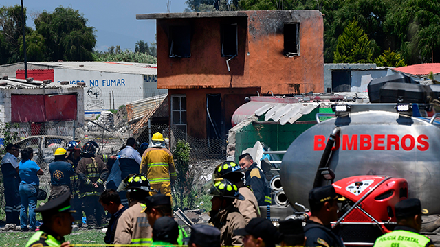 Firefighters work at the site after a series of explosions at fireworks warehouses in Tultepec, central Mexico, on July 5, 2018. (Getty Images)