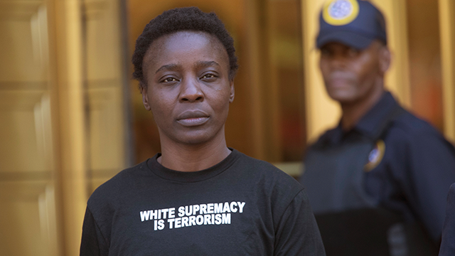"""Therese Okoumou leaves Federal court, Thursday, July 5, 2018, in New York. Okoumou, who climbed the base of the Statue of Liberty on a busy Fourth of July in what prosecutors called a """"dangerous stunt"""" pleaded not guilty. (AP Photo/Mary Altaffer)"""