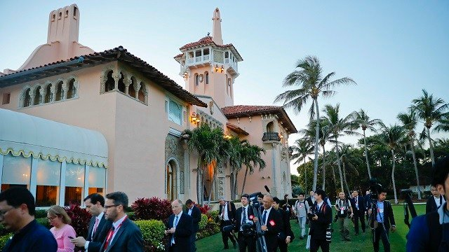 Members of the U.S. and Japanese media walk across the grounds of President Donald Trump's Mar-a-Lago club, during a visit by Japanese Prime Minister Shinzo Abe and his wife Akie Abe, April 18, 2018, in Palm Beach, Fla. (AP Photo/Pablo Martinez Monsivais)