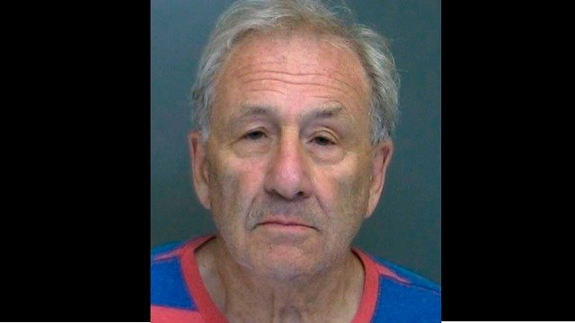 Martin Astrof nearly backed over a campaign worker after saying he wanted to kill supporters of President Trump and Rep. Lee Zeldin. Astrof was charged with making a terroristic threat and reckless endangerment. (Suffolk County Police Department via AP)